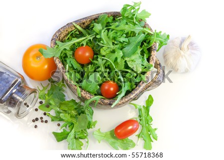salad of arugula and tomato-sherry with garlic