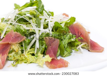 salad of arugula and tuna vegetables on a white background in the restaurant