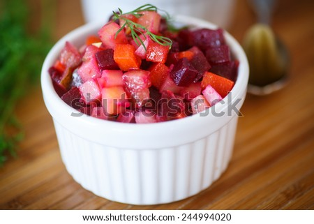salad of boiled vegetables with beetroot and dill - stock photo