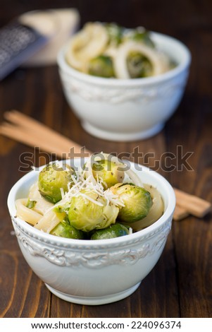 Salad of Brussels sprouts with squid - stock photo