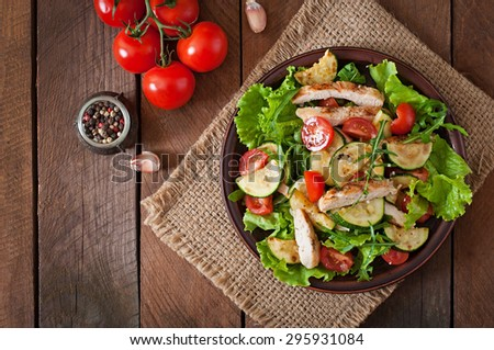 Salad of chicken breast with zucchini and cherry tomatoes. Top view - stock photo