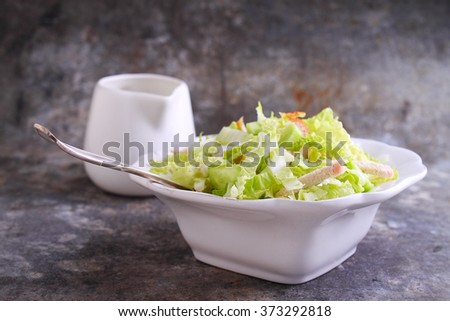 salad of Chinese cabbage, cucumber and chicken in white plate