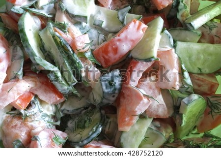 Salad of cucumbers and tomatoes with sour cream