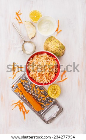 Salad of fresh celery and carrots with  yogurt , ingredients set on white wooden background, top view - stock photo