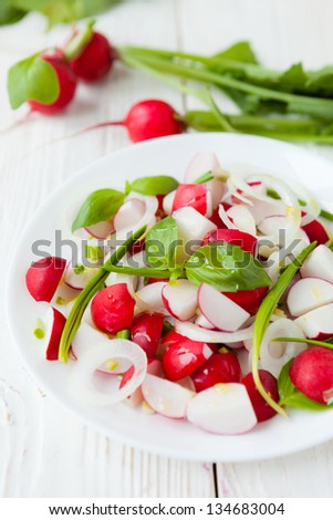 salad of fresh radishes and onions, closeup - stock photo