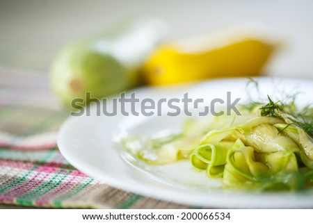 salad of marinated zucchini in spices with herbs - stock photo