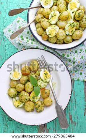 salad of new potatoes, quail eggs and pesto - stock photo