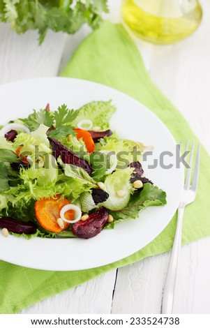 Salad of roast beetroot, orange  and pine nuts - stock photo