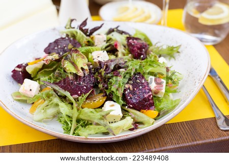Salad of roasted beetroot, pear, spinach, hard cheese, walnuts and quince - stock photo