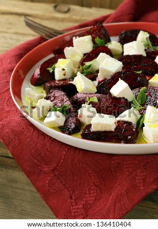 salad of roasted red beets and feta cheese with olive oil - stock photo
