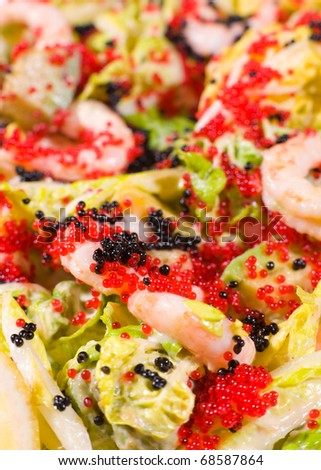 salad of shrimps, avocado and lettuce, served with flying fish caviar, macro
