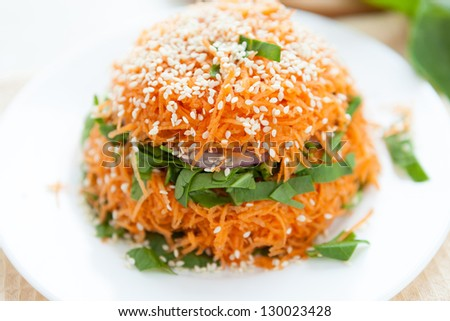 salad of spinach and fresh carrots, closeup - stock photo
