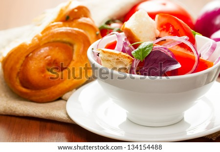 salad of tomatoes, red onions and dried bread - panzanella - Italian cuisine