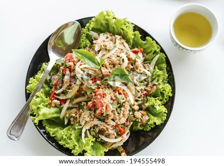 Salad of tuna fish with fresh green tea leaves, Iceberg lettuce, tomato and chili isolated on white background