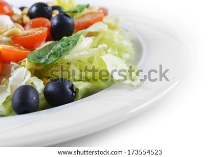 salad of vegetables with cheese and  seeds  on  plate