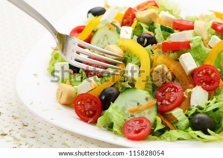 salad of white cheese on a table - stock photo
