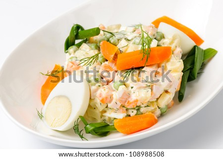 Salad Olivier. Russian traditional salad on a plate