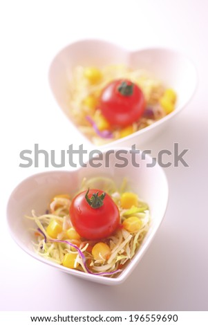Salad on a plate of heart-shaped - stock photo