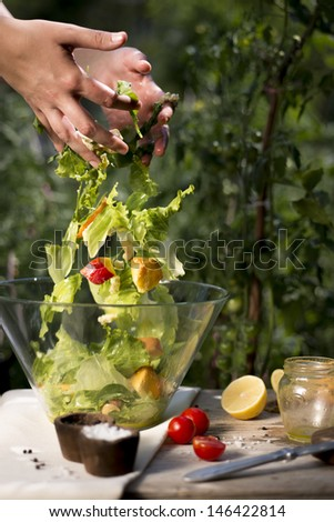 Salad preparation on a traditional wooden table outdoors