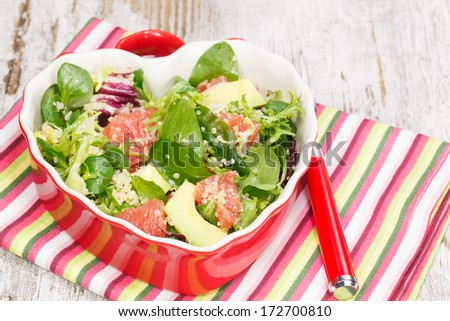 Salad. Quinoa,baby spinach, avocado and grapefruit with a spicy dressing. Macro, close up - stock photo