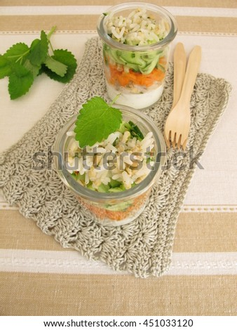 Salad to go in jar with rice, barley, carrot and cucumber