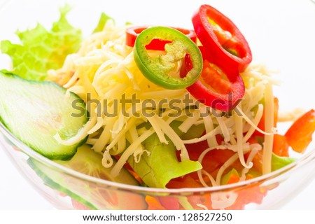 Salad vegetable cucumber, tomato, cheese and pomegranate close-up - stock photo
