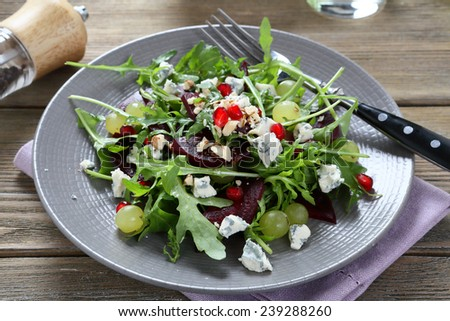 Salad with arugula and beet, food - stock photo