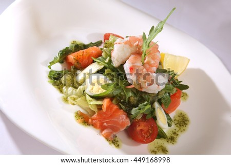 Salad with Arugula and shrimp on plate
