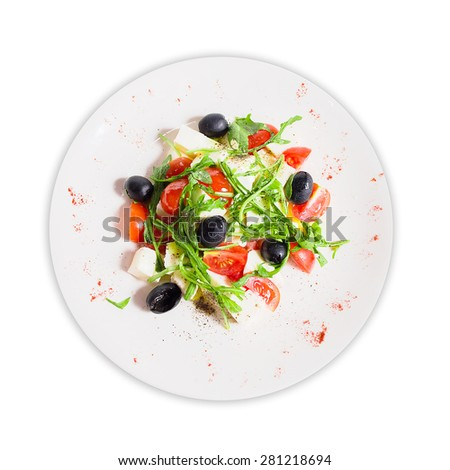 salad with arugula, olives, tomatoes and cheese - stock photo