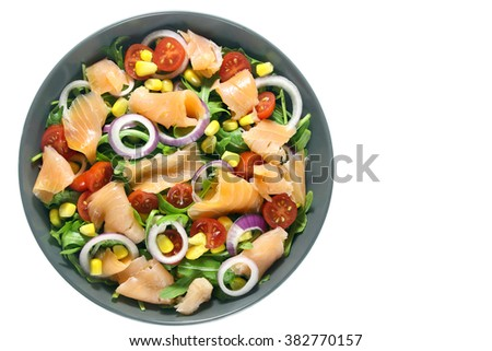 Salad with arugula, tomatoes, corn, smoked salmon and red onion