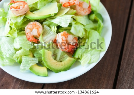 Salad with avocado and shrimps - stock photo