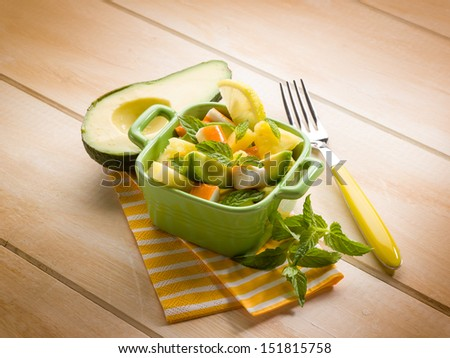 salad with avocado surimi and pineapple