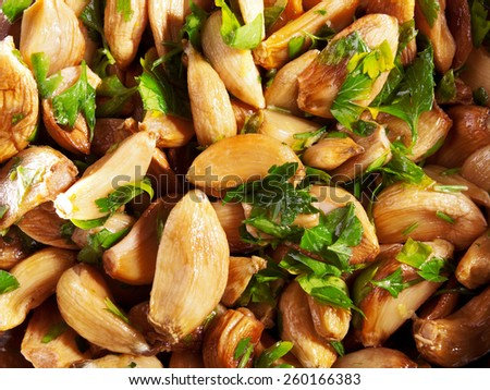 Salad with baked garlic and freshly chopped parsley