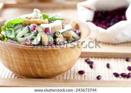 salad with beans, bacon, cucumber and rye croutons - stock photo