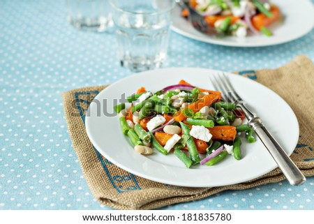 Salad with beans, baked carrots and feta - stock photo