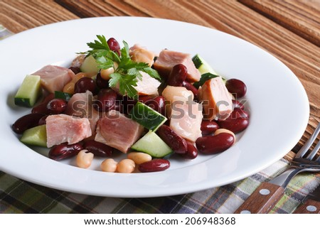 salad with beans, smoked chicken and cucumber on the table horizontal