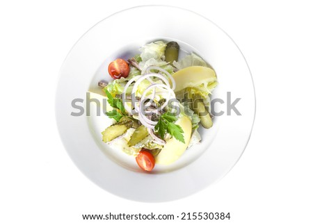 Salad with beef, potatoes, cucumbers and Salen blue bow on a plate of white background - stock photo