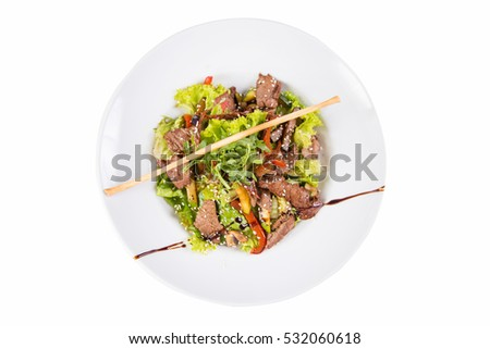salad with beef,sesame and vegetables  isolated on white