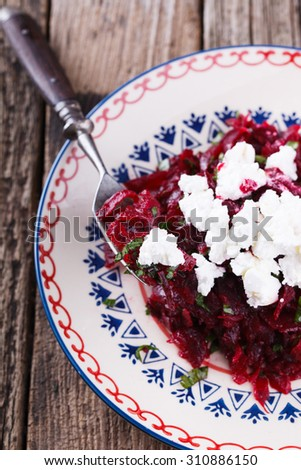 Salad with beets and feta - stock photo