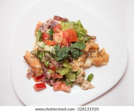 salad with breading cheese, vegetables and sausages