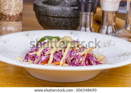 Salad with cabbage, celery, carrot and apple - stock photo