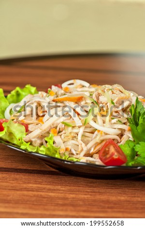 Salad with calamary and fresh vegetable - stock photo
