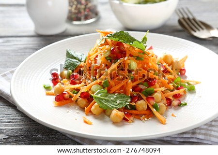 Salad with carrots and chickpeas, food - stock photo