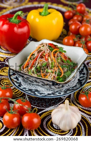 Salad with Cellophane noodles, carrots, spicy, sweet pepper, cucumber, roast beef, garlic, celery, cilantro - stock photo