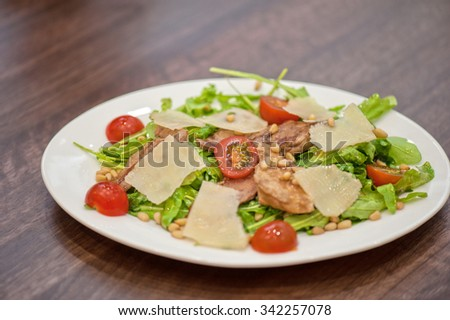 Salad with chicken and parmesan  - stock photo