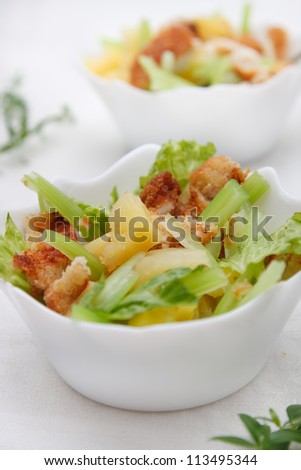 Salad with chicken, celery and pineapple - stock photo