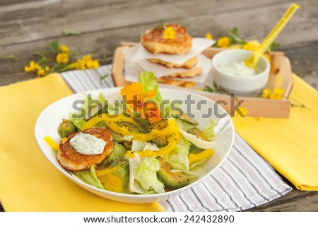salad with corn fritters - stock photo