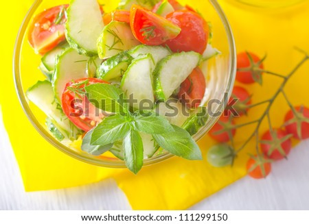 salad with cucumber and tomato - stock photo