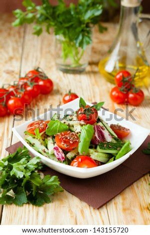 salad with cucumbers and tomatoes, close up - stock photo