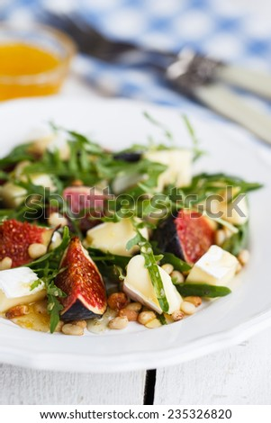 Salad with figs, pine nuts,Camembert Cheese and honey. - stock photo